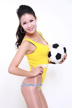 Chinese woman holding a soccer ball