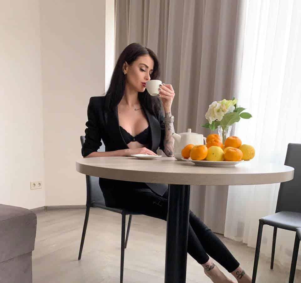 Kristina Stoloka drinking coffee in the morning
