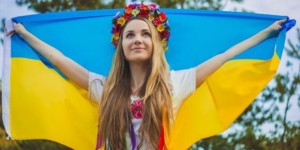 Blonde Ukraine girl with a flag