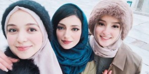 three charming Moroccan girls with a sweet smile
