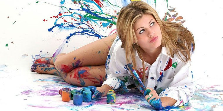 blonde girl getting messy with paint