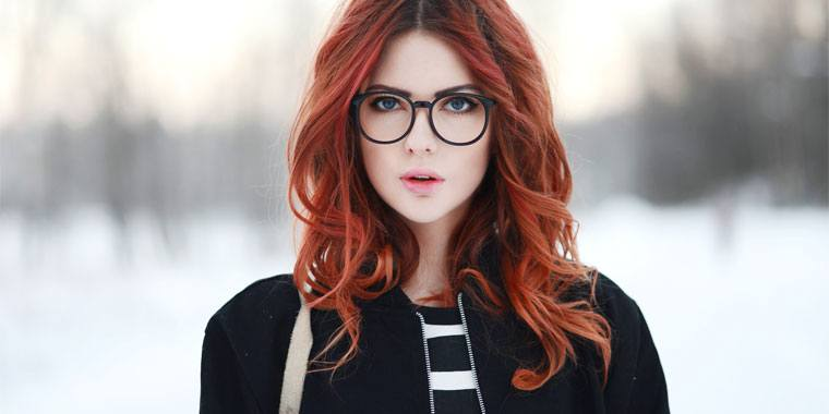 hot redhead wearing glasses