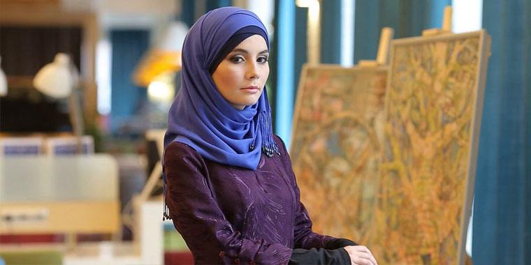 Muslim girl in a cafe