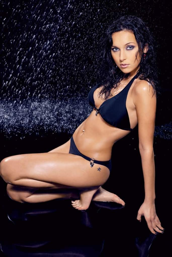 Alsou in black bikini rain