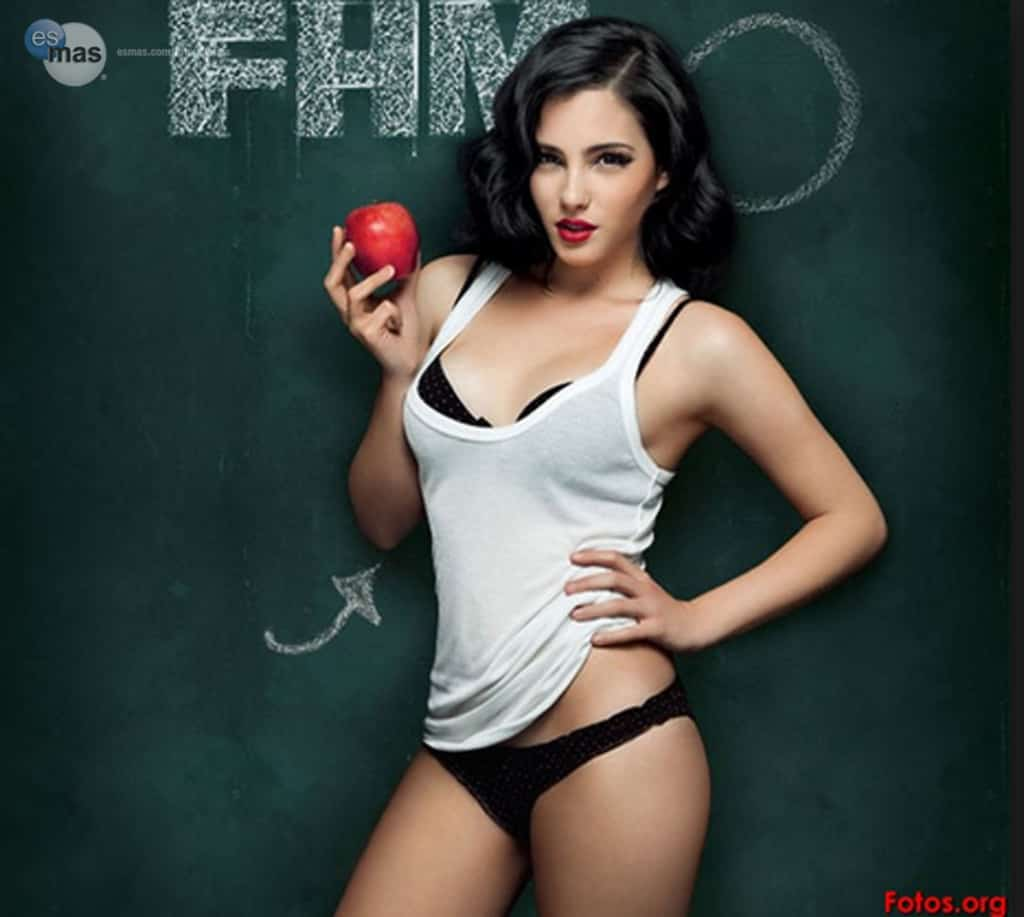 Andrea Duro holding an apple for FHM magazine