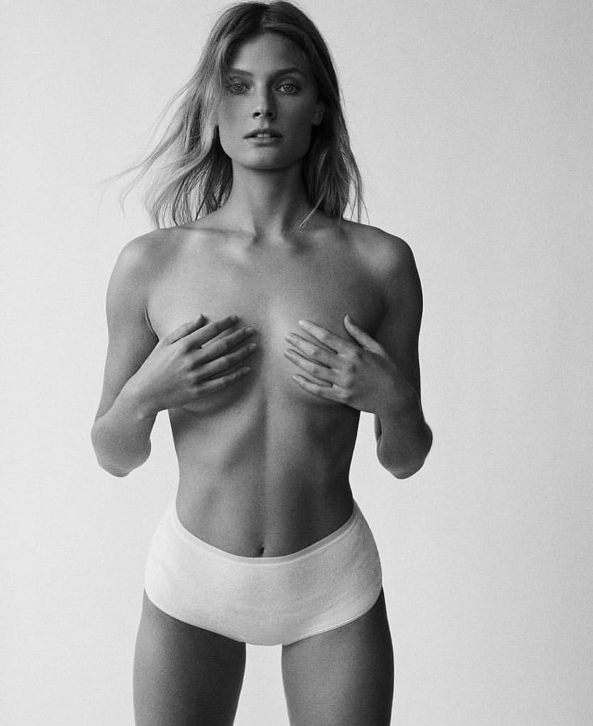 Constance Jablonski topless in a black and white photo