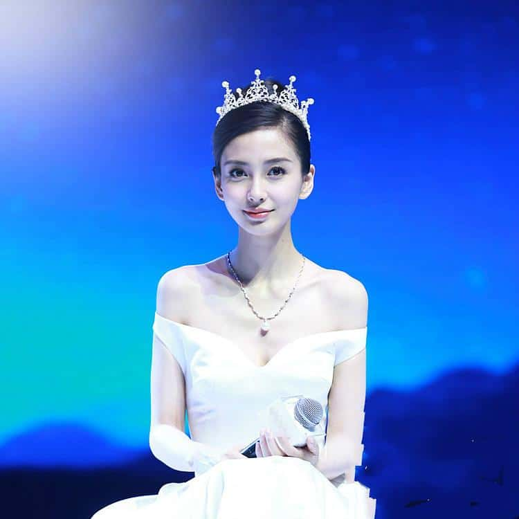 Angelababy wearing a princess pearl rhinestone crown