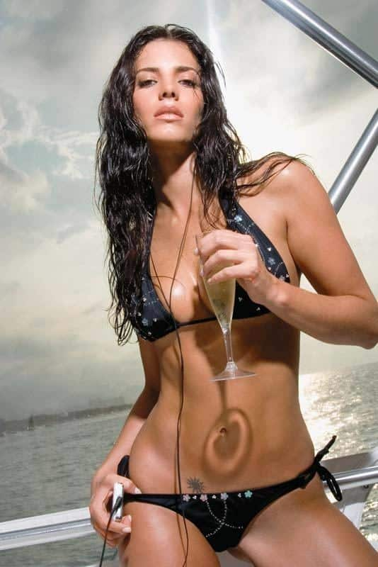 Gaby Espino on a yacht holding a champagne