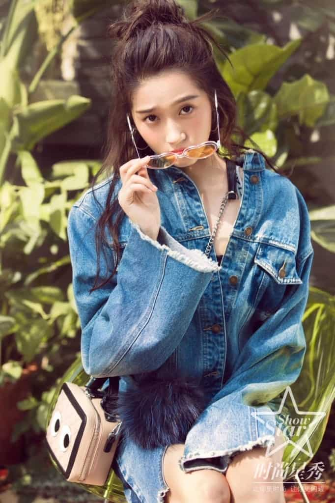 Guan Xiaotong in denim jacket