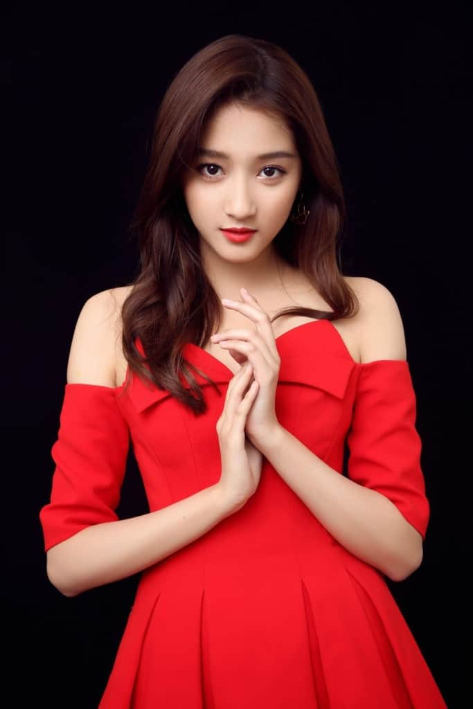 Guan Xiaotong wearing elegant red dress