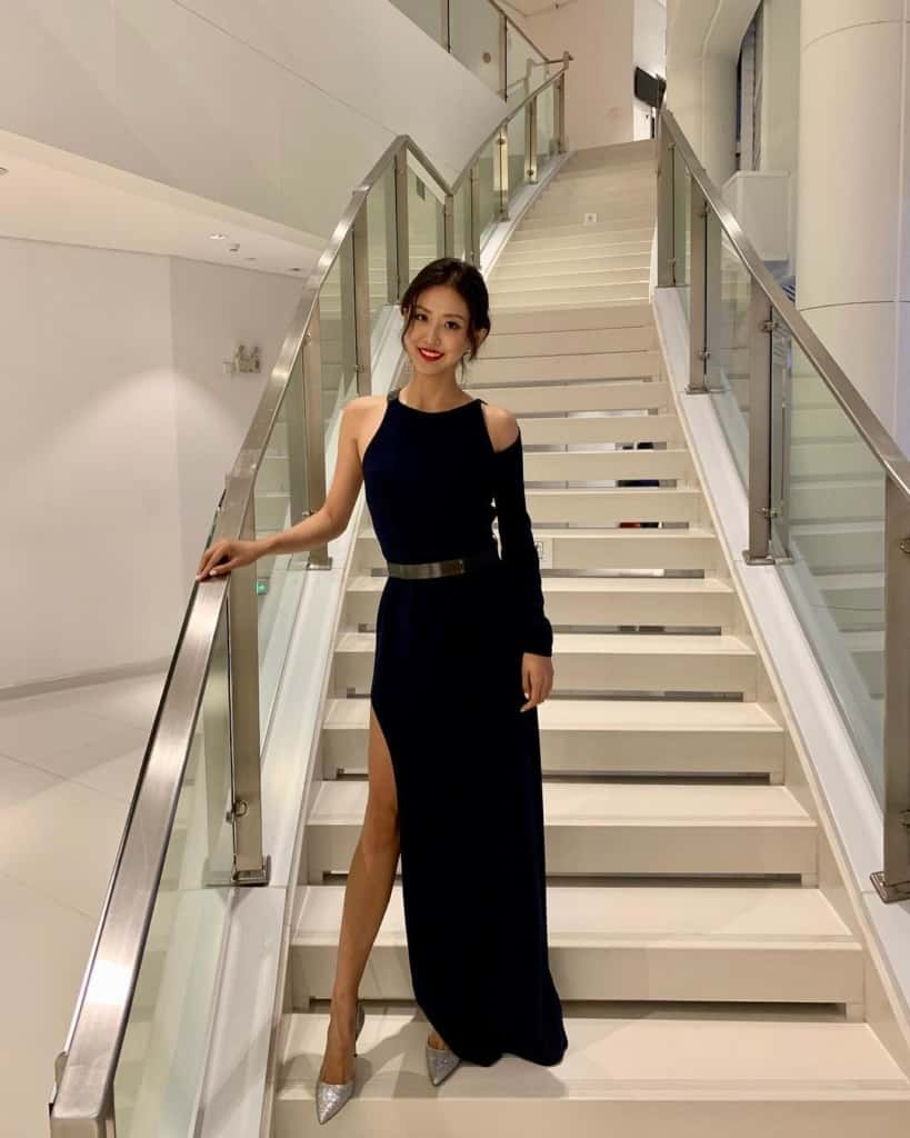 Jessica Xue in an elegant long black dress
