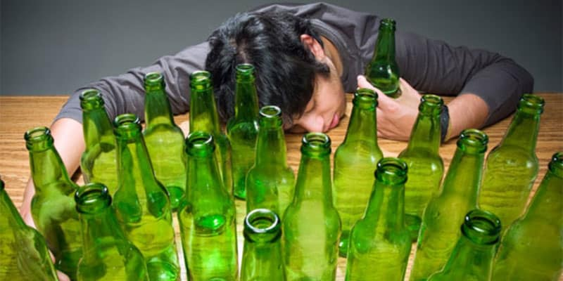 man passed out because of excessive drinking