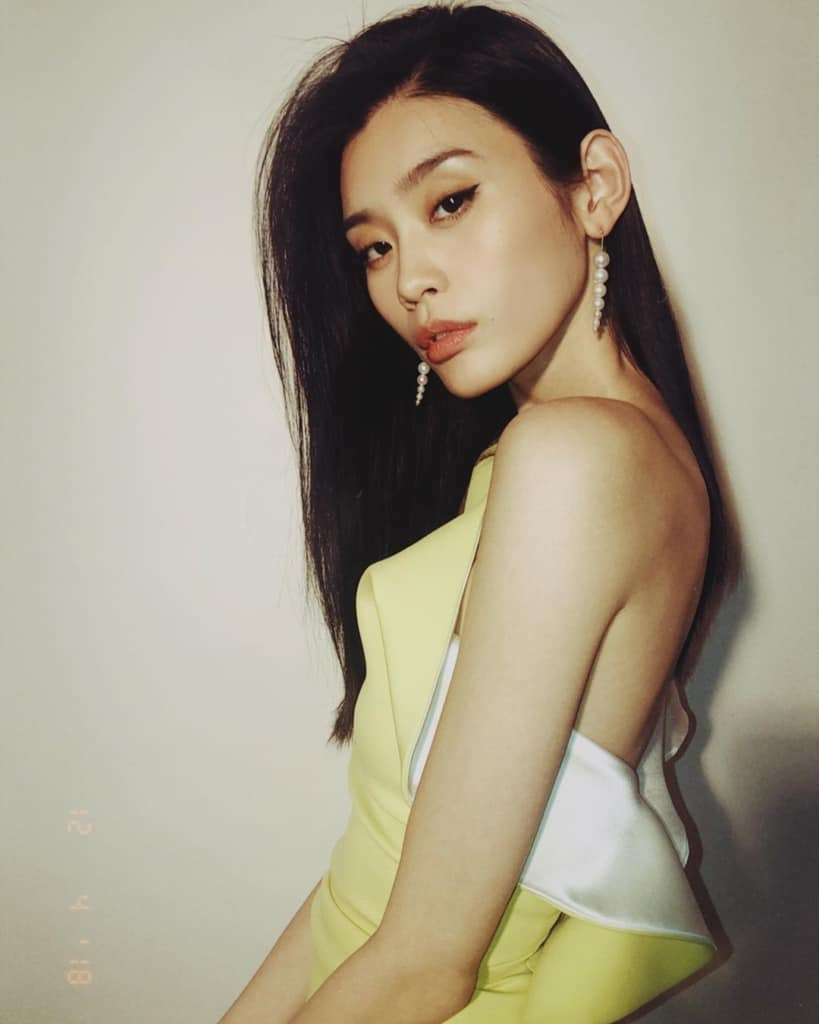 Ming Xi seductive in a yellow dress