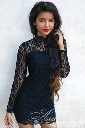 sultry Indian babe wearing a black flower laced dress