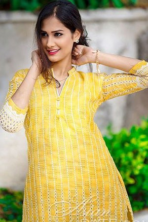 sultry Indian girl in a nice yellow dress