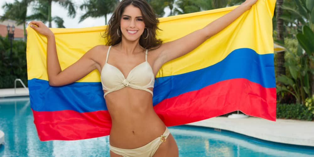 sexy Colombian girl holding a Colombian flag