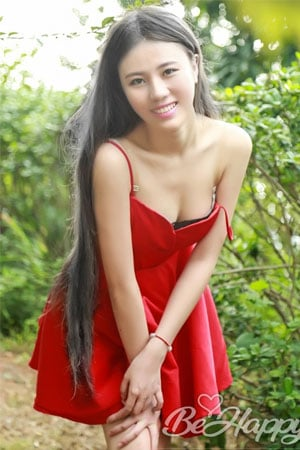 seductive Chinese babe in red dress