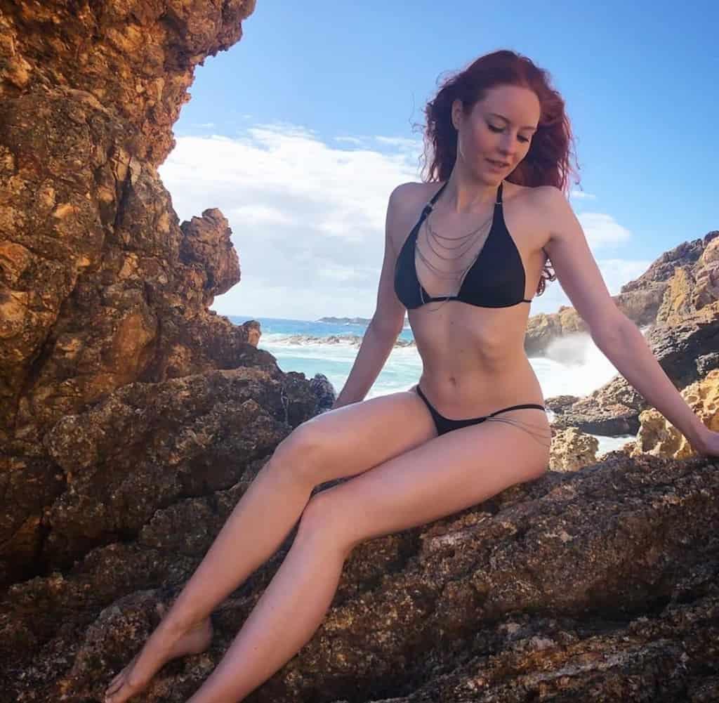 Barbara Meier posing on the rocks