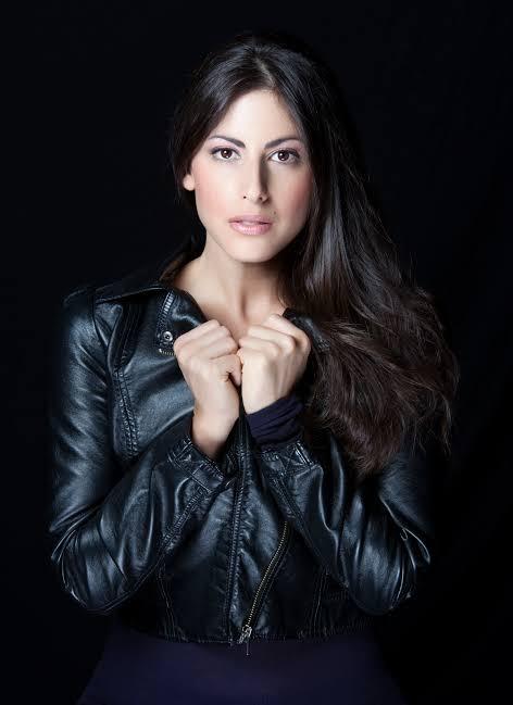 Roni Meron wearing a black leather jacket