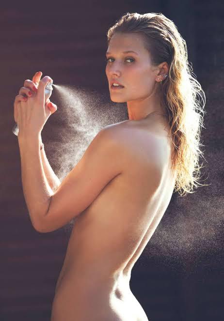 Toni Garrn spraying perfume