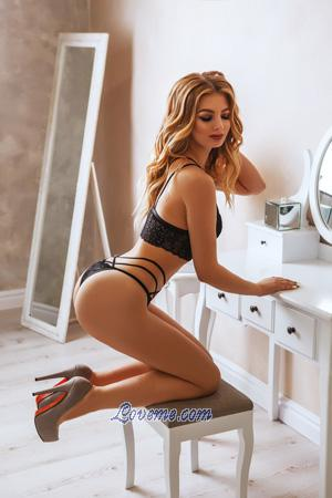 curly Ukraine blonde in front of the mirror