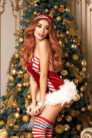 sexy Ukrainian journalist beside the Christmas tree
