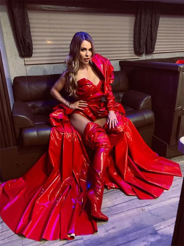 Doda wearing an all red dress backstage