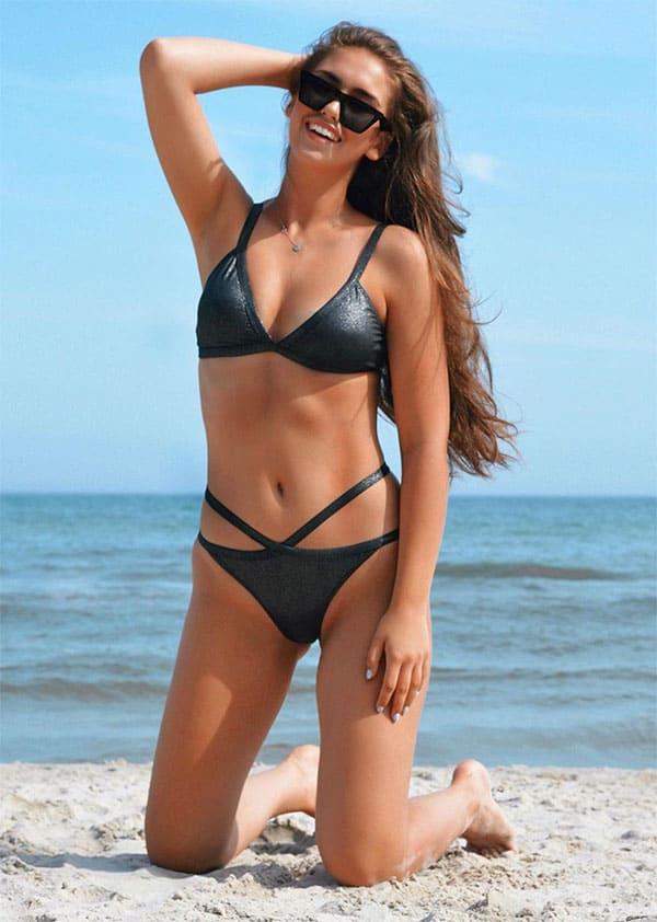 Klaudia Kucharska at the beach in black two piece bikini