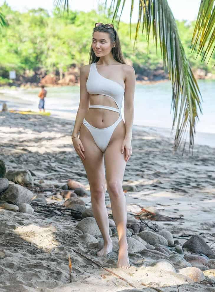 Roxxsaurus stunning in a white swimsuit bikini