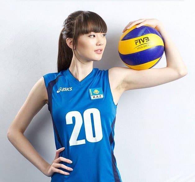 Sabina Altynbekova holding a volleyball