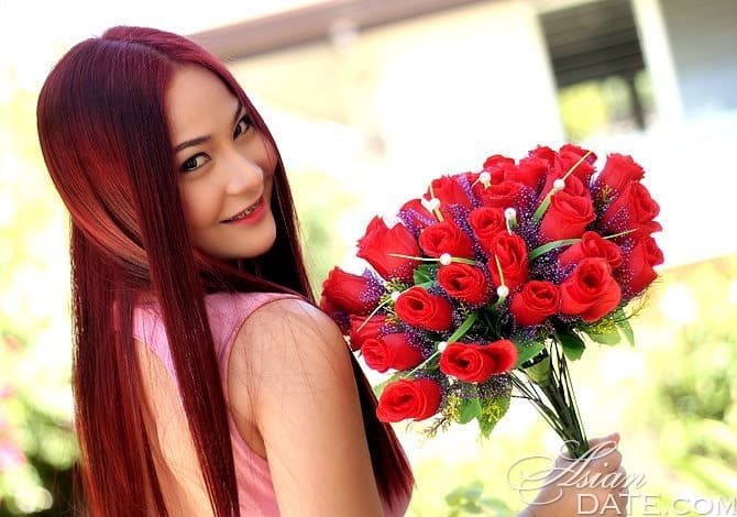 beautiful Filipina holding a bouquet of flowers