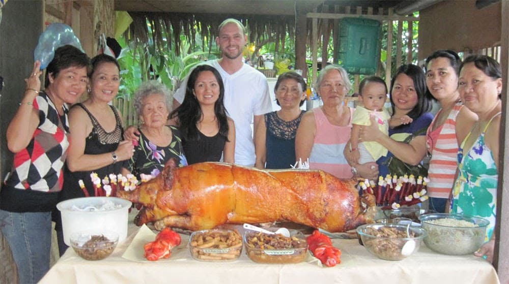 American and Filipina couple with her family