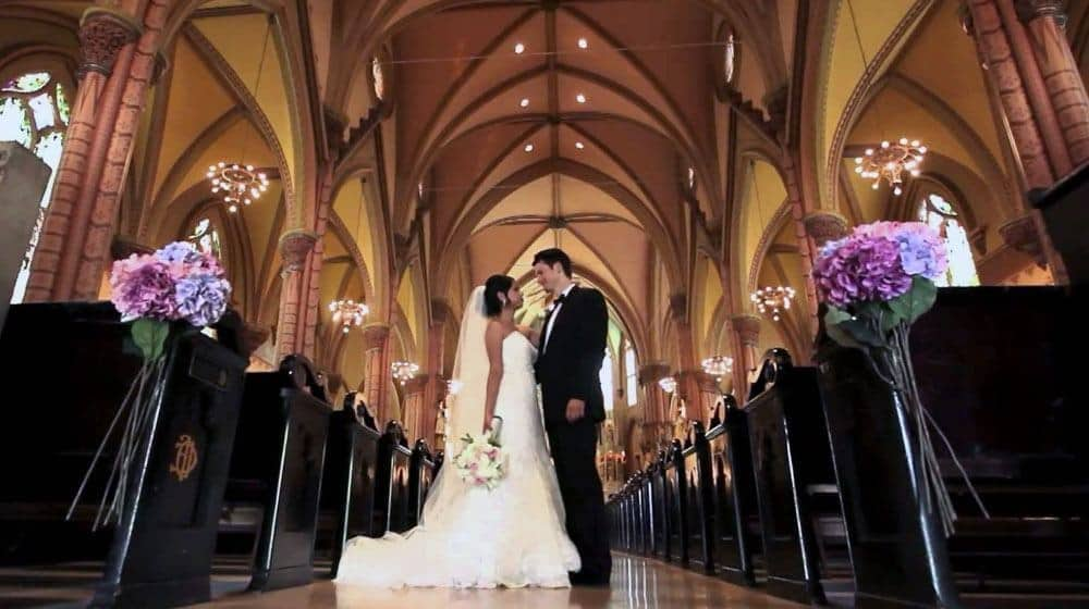 American man with his Filipina wife at the church