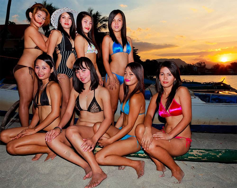 Beautiful women of the Philippines at beach in bikinis