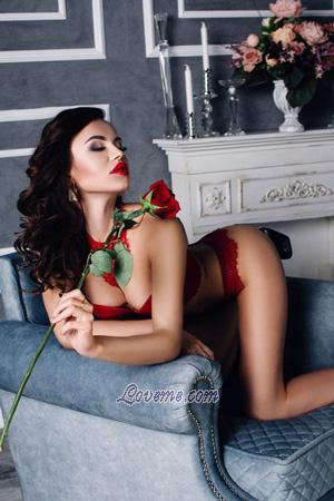 seductive Russian girl on the couch holding a rose
