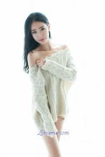 appealing Chinese babe in a sweater