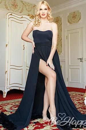 sexy blonde Ukraine babe in cocktail dress